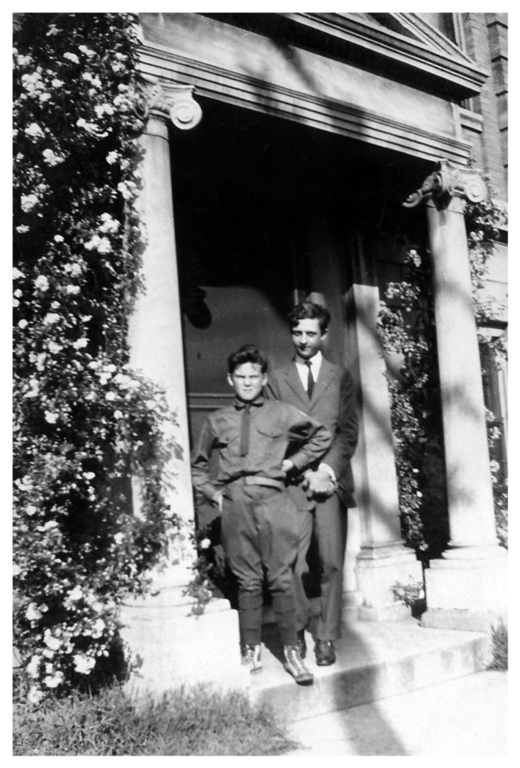 (Untitled) [Hugh and Ralph? By door with flowers]